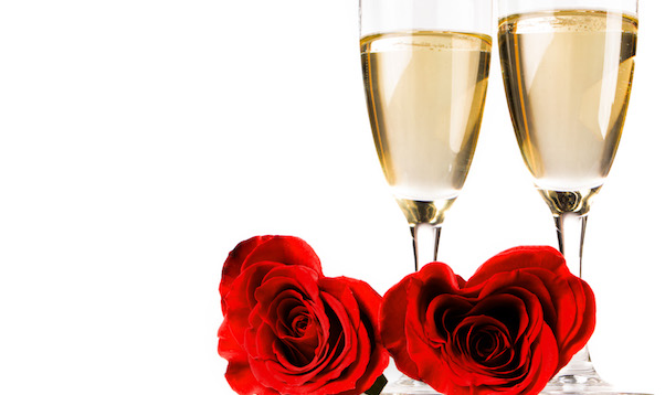 Two heart shaped red roses and champagne isolated on white background, Valentines day