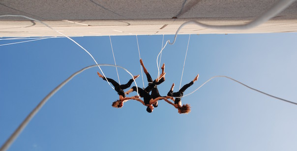 Acrobats suspended from wall at Segerstrom Hall