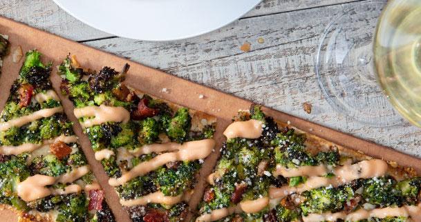 Seasons 52 broccoli flatbread and white wine