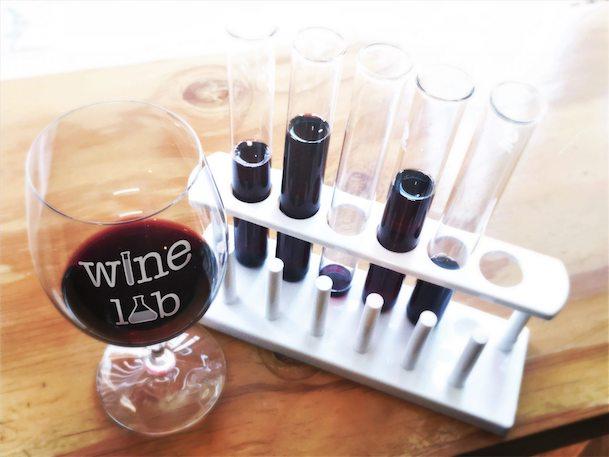 Wine Lab wine glass with logo and wine flight