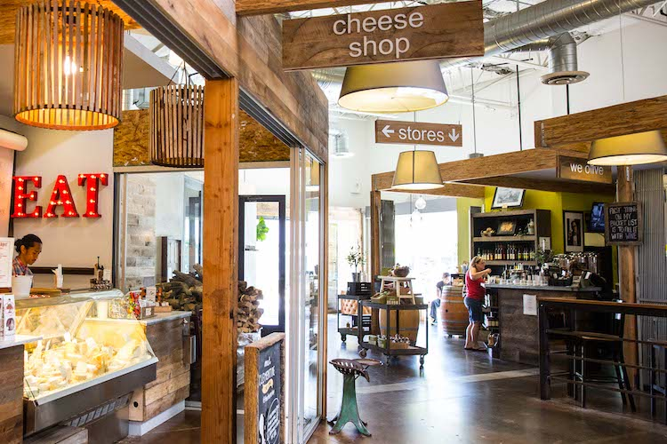 Exterior of The Cheese Shop and We Olive & Wine Bar at SOCO & The OC Mix.